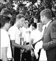 bill clinton shakes JFK's hand