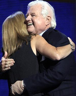 Ted and Caroline share a hug