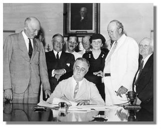 Franklin D. signs Social Security into law