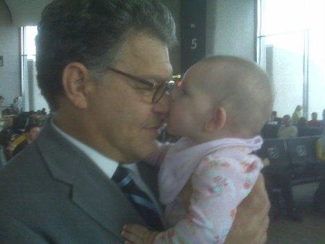 Baby biting Al Franken