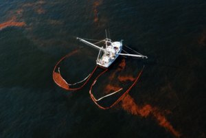 National Geographic's pictures of a fishing boat tackling the oil spill